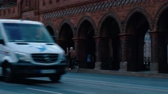 Pan, right to left, medium shot of traffic at Oberbaum Bridge, in Berlin. Stock Footage