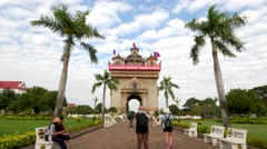 TIMELAPSE Tourists photographing Patuxai monument,Vientiane,Laos Stock Footage