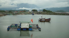 The small mooring with national flag of Vietnam on water for local fishing Stock Footage