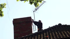 Chimney Sweep On The Top Of The Roof HD Stock Footage