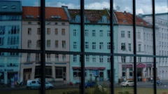 City reflection off the panoramic facade window of the modern building in Berlin Stock Footage