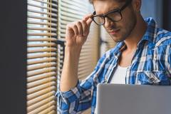 IT Guy adjusts his glasses Stock Photos