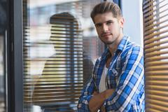 Businessman resting in a window Stock Photos