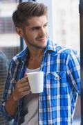 Young businessman enjoying mug of coffee Stock Photos