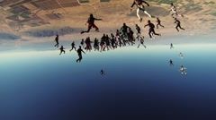 Many skydivers make big figure in cloudy evening sky. Extreme. Holding hands Stock Footage