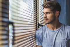Man daydreaming at work Stock Photos
