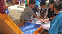 Boys gambling with money in dice game,Vang Vieng,Laos Stock Footage