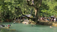 Tourists swimming and diving in blue lagoon,Vang Vieng,Laos Stock Footage