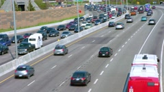 Wide shot of highway with traffic jam in one direction and other side flowing Stock Footage