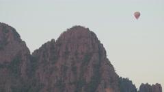 Hot air balloon over karst mountains,Vang Vieng,Laos Stock Footage