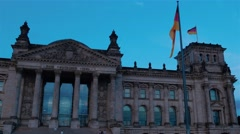 Bundestag at evening time in Berlin, German flags are waving on the wind. Stock Footage