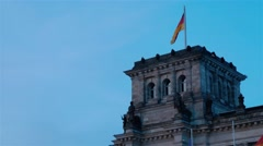 Waving flag on the wind at the top of the Deutche Bundestag in Berlin. Stock Footage