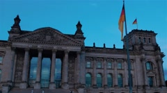 Real time. German flags are waving on the wind. Deutche Bundestag in Berlin Stock Footage