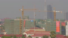Construction site with crane lifting,Vientiane,Laos Stock Footage
