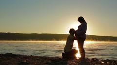 A Pregnant Woman And Expectant Father On Lake Silhouette Stock Footage