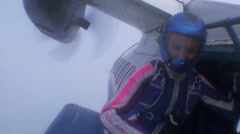 Skydiver jump from airplane in evening sky. Clouds. Speed. Freestyle. Extreme Stock Footage