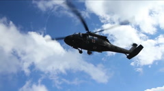 An emergency rescuer rappels from a helicopter during a rescue. Stock Footage