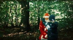 In the Early Autumn the Boy Scoffs at Santa - Beats Him and Pulls Clothes Stock Footage