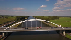 Aerial of arched bridge in Dutch landscape Stock Footage