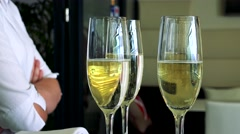Detail of glasses with champagne - detail - waiter stand next to glasses Stock Footage