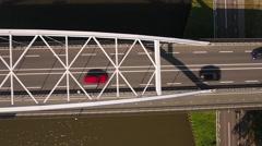 Traffic crossing steel bridge, bird's eye perspective. Stock Footage
