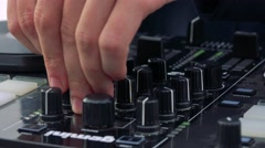 Dj mixing music on dj pult - sound equalizer - detail Stock Footage