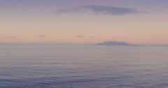 Aerial over beach and waves crashing in calm ocean at Tawharanui, auckland Stock Footage