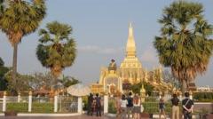 Tourists at King Setthathirat statue That Luang,Vientiane,Laos Stock Footage
