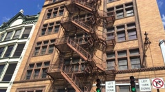 Establishing Shot of City Apartment Building with Fire Escape Stock Footage