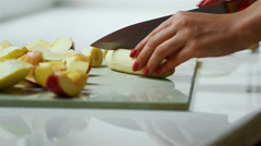 Girl cleans and cuts the banana for making cake Stock Footage