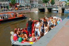 Amsterdam. Excursion boats on the canals. Stock Photos