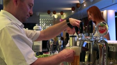 Man taps beer in a restaurant (bar) Stock Footage