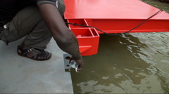 An African laborer works on a pier. Stock Footage