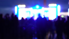 People silhouettes at night live show. 4K background bokeh shot Stock Footage