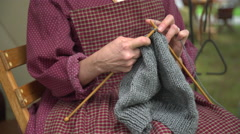 Woman knitting in a civil war camp Stock Footage