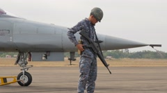 Young soldier guards military airport,Ubon Ratchathani,Thailand Stock Footage