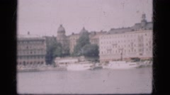 1948: a city is seen with tall buildings along a coastal area Stock Footage