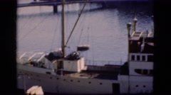 1948: large boat on calm blue water and a beautiful concrete building  Stock Footage