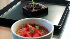 Chocolate dessert on the plate with strawberry dessert in bowl - detail Stock Footage