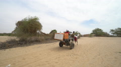 Heat African barren landscape - cart moving in the background Stock Footage