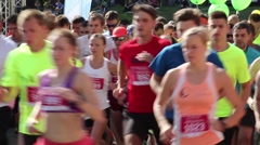 City Marathon Runners Running By Just After Start. HD Stock Footage