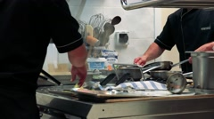 Chefs cook in the professional kitchen in the restaurant  Stock Footage