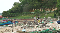 Asian fishermen dismantle fishing nets on the river bank in a suburb of Stock Footage