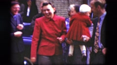 1948: a happy gathering in the street among people dressed in red and blue Stock Footage
