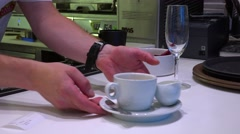 Barman prepares coffee in the restaurant bar - waiter takes it away  Stock Footage