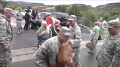 Stranded people and pets are rescued from a remote community during flooding in Stock Footage