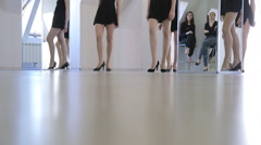Down view of females walking up and down under control Stock Footage
