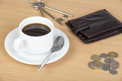 Cup of coffee on table with a wallet and cash Stock Photos