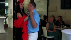 Woman singer dances with man in the restaurant - celebration event Stock Footage