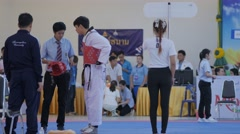 Referee puts sensor in helmet of Taekwondo player,Ubon Ratchathani,Thailand Stock Footage